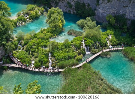 PLITVICE, CROATIA - JULY 7: Tourist enjoy sightseeing the lakes and wonderful landscapes at the Plitvice natural Park in Croatia during the summer holidays, on July 7th, 2011 in Plitvice, Croatia - stock photo