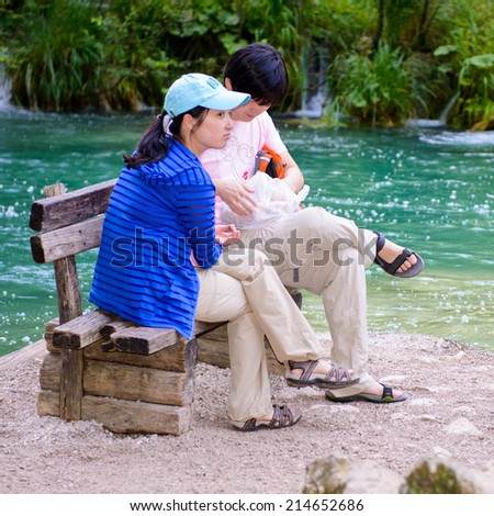 PLITVICE LAKE NATIONAL PARK, CROATIA - AUG 19, 2014: Unidentified couple make photos in the Plitvice Lakes National Park, which is a UNESCO World Heritage site