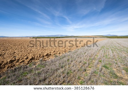 Ploughed and stubble fields in an agricultural landscape in Guadalajara Province, Spain - stock photo