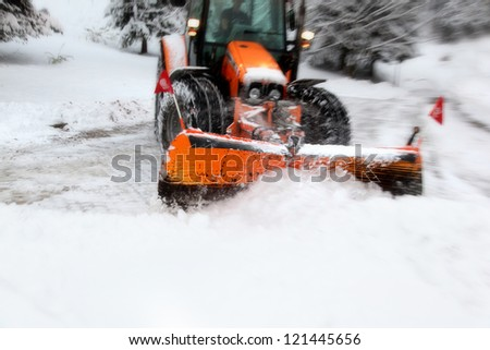 Plow removing snow from city street. Motion blur visualizies the speed and dynamics. - stock photo