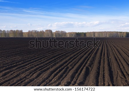 Plowed black earth - stock photo