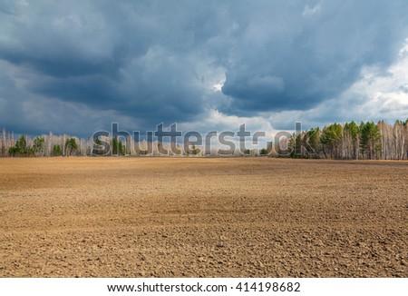 Plowed field. - stock photo