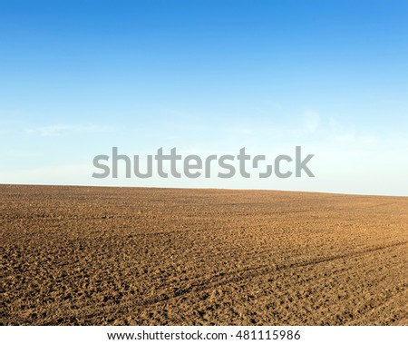 Plowed field for planting winter crops a clear autumn day. Photo is easy to toned.
