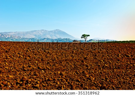 Plowed Sloping Fields of Tuscany in the Autumn - stock photo