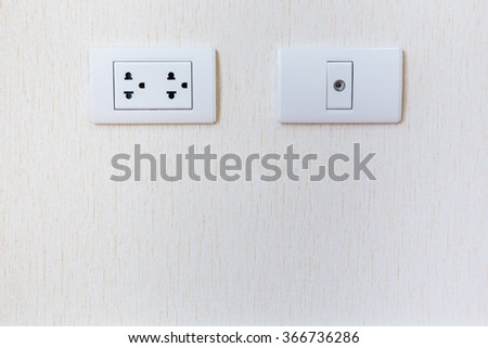 Plug socket in wall close up. - stock photo
