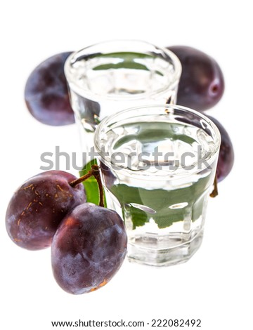 Plum brandy with plums isolated on white background - stock photo