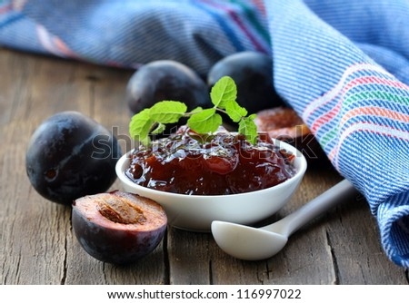 plum jam and mint in a white cup - stock photo
