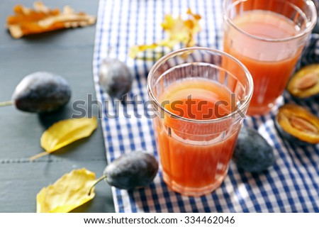 Plum Juice in a glasses with fresh fruits - stock photo
