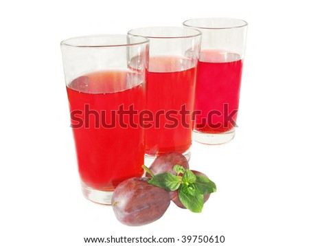 plum juice in three glasses with plums and mint
