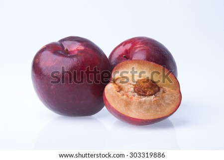 Plum. Ripe plum fruit on the background