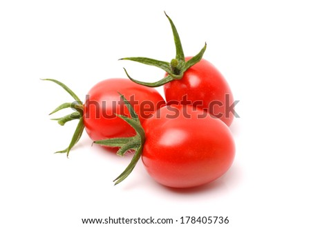 Plum tomatoes with leaves on white background  - stock photo