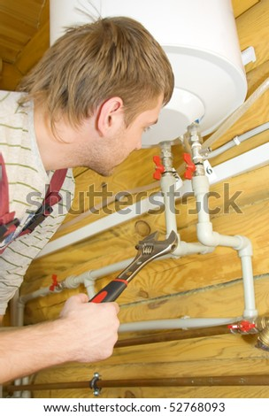 Plumber at work. Servicing boiler - stock photo