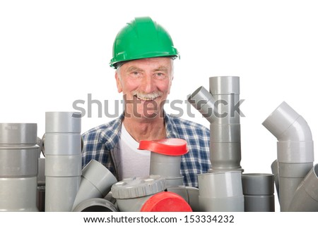 Plumber confused by assortment pvc tubes - stock photo