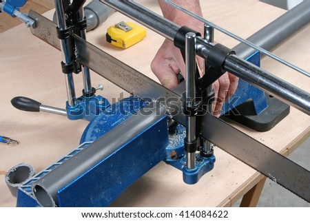 Plumber cutting pvc pipe with a saw & Plumber Cutting Pvc Pipe Saw Stock Photo (Royalty Free) 414084622 ...
