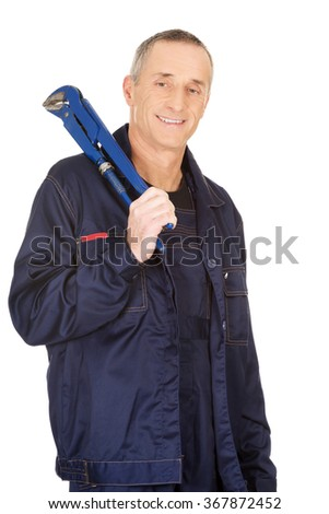Plumber holding a wrench - stock photo