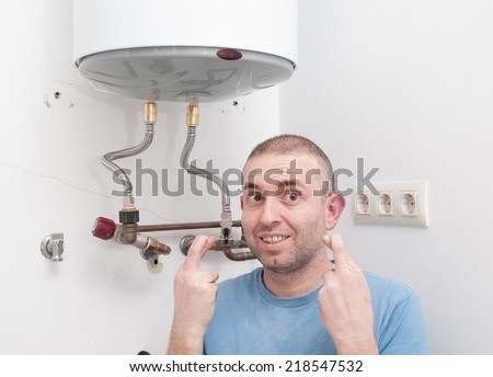 Plumber home hoping to get lucky with the installation of electric heat - stock photo
