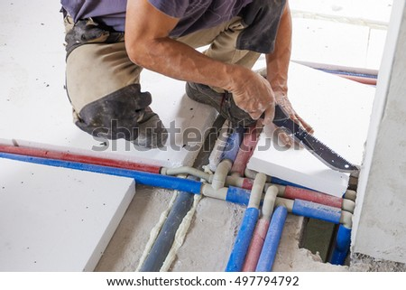 Plumber installs central heating