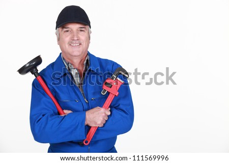 plumber ready to unclog a sink - stock photo
