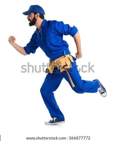 Plumber running fast - stock photo