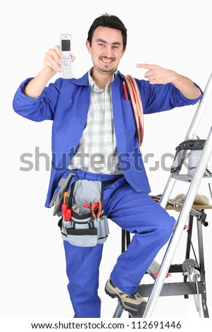 plumber showing cell phone - stock photo