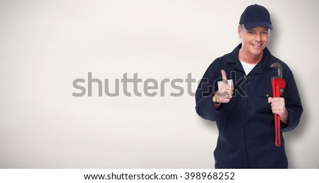 Plumber with a wrench. - stock photo