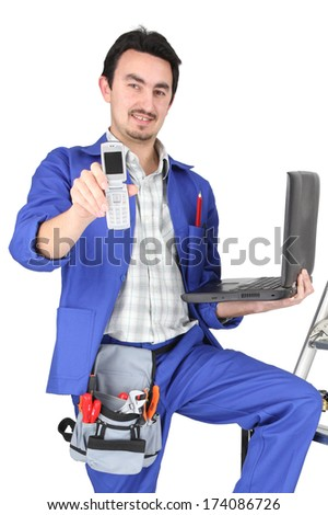 plumber with computer showing phone - stock photo