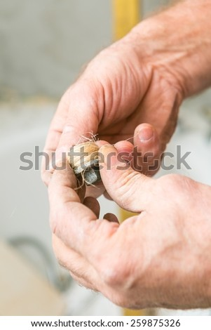 Plumber working with water installation, only hands. - stock photo