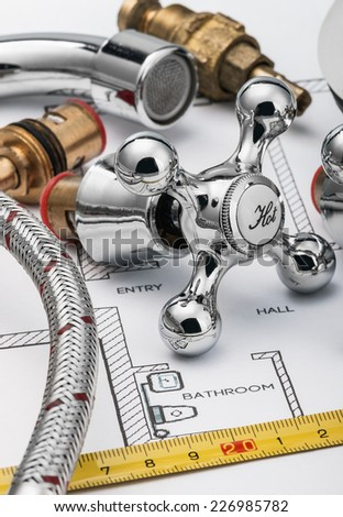 plumbing and tools lying on drawing for repair - stock photo