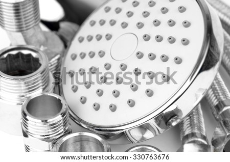 Plumbing fitting, hosepipe and showerhead, close up, DOF - stock photo
