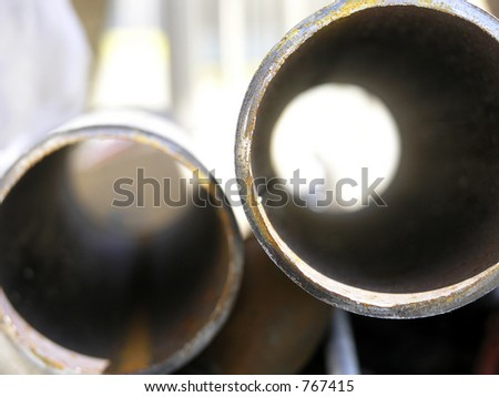 Plumbing pipes, end view abstract with steep DOF blur to soft background