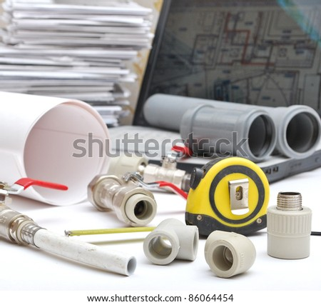 Plumbing tool pipes and fittings - stock photo