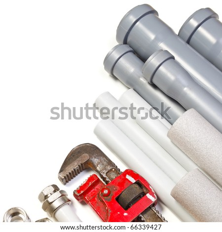 Plumbing tool pipes and fittings on white background - stock photo