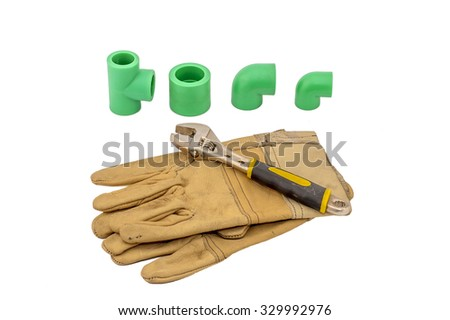 Plumbing tool pipes, glove and spanner on white background, concept of reconstruction flats and houses