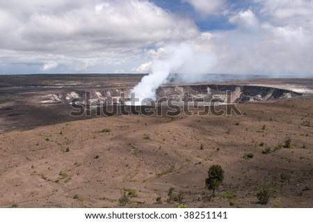 Plume of steam and sulfur gas, active eruption inside Halemaumau Crater of the Kilaeua volcano, Big Island, Hawaii - stock photo