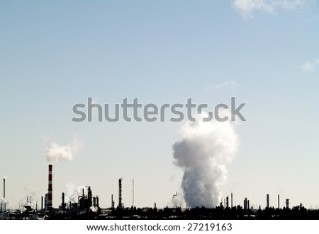 Plume of vapor from a petrochemical plant east of Edmonton, Alberta in Strathcona County - stock photo