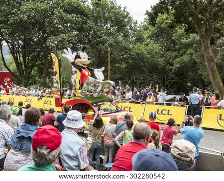 PLUMELEC , FRANCE - 12 JUL: Mickey's car during the passing of the Publicity Caravan before the Team Time Trial stage between Plumelec and Vannes, during Tour de France on 12 July, 2015. - stock photo