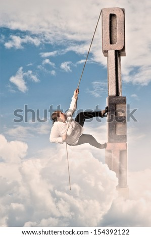 plump woman climbing on diet word - stock photo