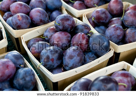 Plums in Basket at Market - stock photo