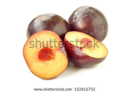 plums on a white background, close-up - stock photo