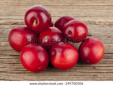 plums on a wooden background - stock photo