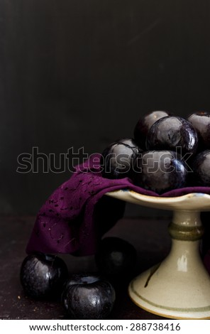 Plums  Still life capture of Plums on a Cake Stand - stock photo