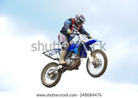 PLUNGE,LITHUANIA-MAY 11:fantastic rider flight in Lithuanian Open Motocross Championship on May 11,2012 in Plunge, Lithuania. - stock photo