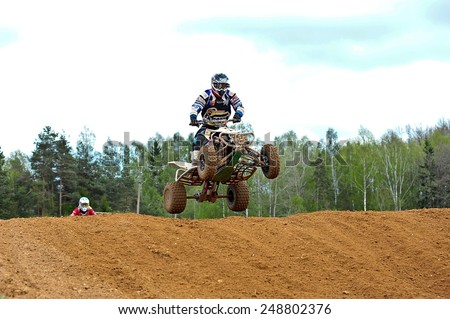 PLUNGE,LITHUANIA-MAY 11:Unidentified rider in flight in Lithuanian Open Motocross Championship 2012 first round on May 11,2012 in Plunge, Lithuania.