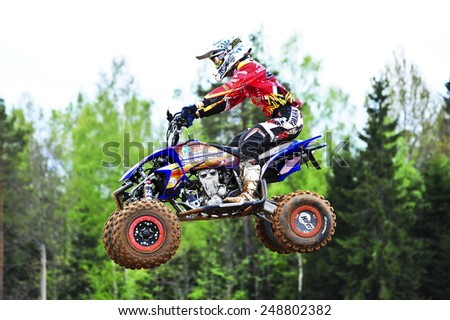 PLUNGE,LITHUANIA-MAY 11:Unidentified rider in flight in Lithuanian Open Motocross Championship 2012 first round on May 11,2012 in Plunge, Lithuania. - stock photo