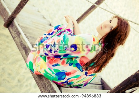 Plus size model is sitting on stairs. - stock photo