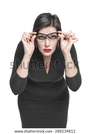 Plus size woman in glasses looking on you isolated on white background - stock photo