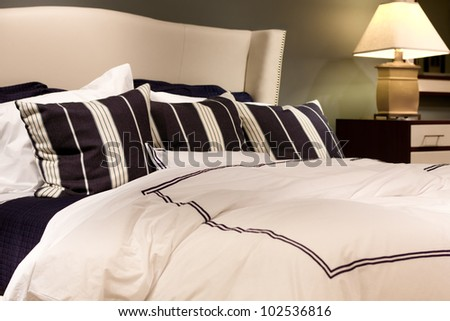 Plush comfortable  contemporary bed in setting - stock photo