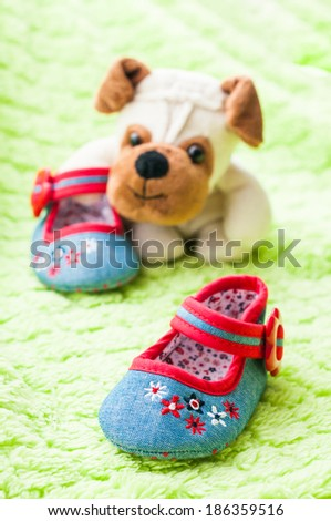 Plush puppy covenant baby shoe. - stock photo