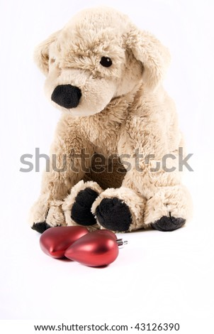 Plush puppy with two hearts