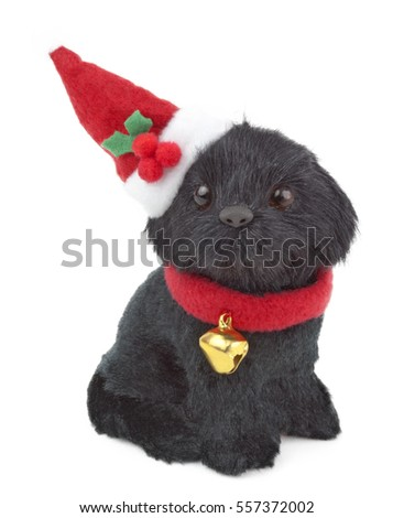 Plush toy puppy wearing Santa hat. Isolated.